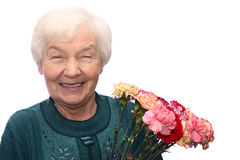 Old woman with flowers. Smiling old woman with bunch of flowers, isolated on white background Stock Images