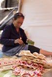 Old woman folding banana leaf Stock Photos