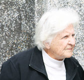 Old woman frowning Royalty Free Stock Photos