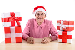 Old woman with gift boxes Royalty Free Stock Image