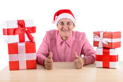 Old woman with gift boxes Royalty Free Stock Photos