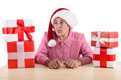 Old woman with gift boxes Royalty Free Stock Photo