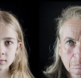 Old woman and girl comparison. Grandmother and granddaughter comparison on black isolated background royalty free stock image