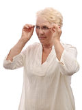 Old woman in glasses looking down Stock Photos