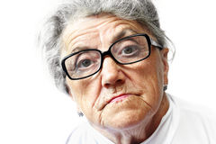Old woman in glasses Stock Photos