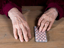 Old woman going to take the medicine Stock Images