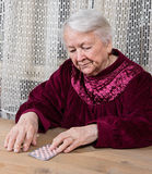 Old woman going to take the medicine Royalty Free Stock Photo