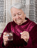 Old woman going to take the medicine Stock Photos