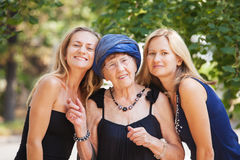 Old woman with granddaughters Royalty Free Stock Photo