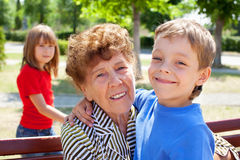 Old woman with grandson Stock Photography