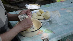 Old woman grater potato stock video footage