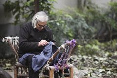 Old woman sewing in Hangzhou, China stock photography