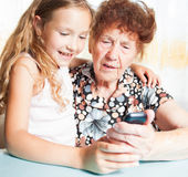 Old woman with great-grandchild Royalty Free Stock Photography