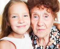 Old woman with great-grandchild Stock Photo