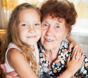 Old woman with great-grandchild Stock Photos