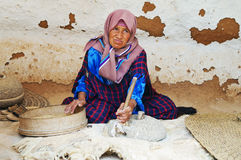 Old woman grinds grains Royalty Free Stock Photography