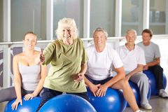Old woman in gym holding thumbs up Stock Photos