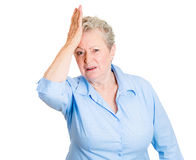 Old woman with hand on head Stock Images