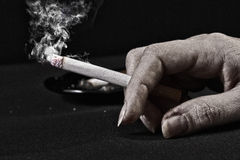 Old Woman Hand Holding A Cigarette Stock Photos