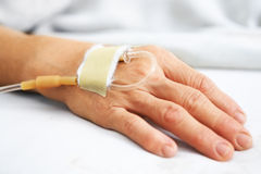 Old woman hand with IV royalty free stock photo