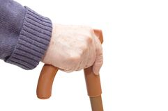 Old woman hand leans on walking stick Royalty Free Stock Photography