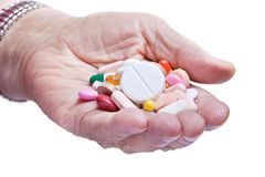 Old woman hand and pills Royalty Free Stock Photography