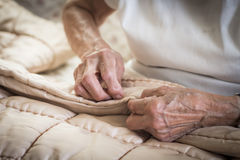 Old woman hand sewing Stock Photography