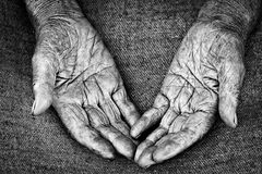 Old woman hands. Close-up shot of open palms of old woman, shallow DOF Royalty Free Stock Images
