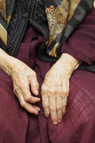 Old woman hands. Laying on her knees Stock Photo