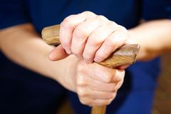 Old woman hands with cane Stock Images