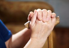 Old woman hands with cane Royalty Free Stock Image