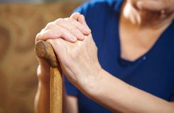 Old woman hands with cane Royalty Free Stock Images