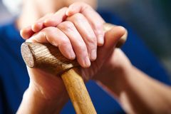 Old woman hands with cane Royalty Free Stock Photography