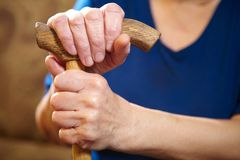 Old woman hands with cane Stock Photos