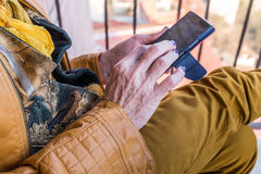 Old woman hands holding smartphone Royalty Free Stock Image