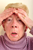old woman has a painfull headache Stock Images