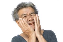 Old woman have toothache on white stock photography
