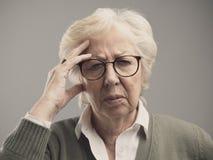 Old woman having a bad headache stock photography