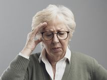 Old woman having a bad headache royalty free stock images