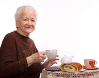 Old woman having breakfast Stock Photo