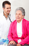 Old woman having a check up Stock Photo