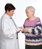 Old woman having discussion with her doctor Stock Image