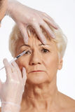 An old woman having a injection- beauty concept. Stock Image