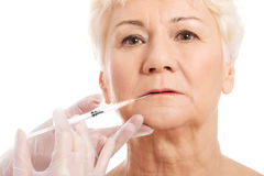 An old woman having a injection- beauty concept. Royalty Free Stock Photography