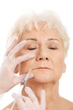 An old woman having a injection- beauty concept. Stock Photos
