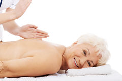 An old woman is having a massage. Spa concept. Over white Royalty Free Stock Images