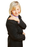 Old woman having shoulder pain Stock Image