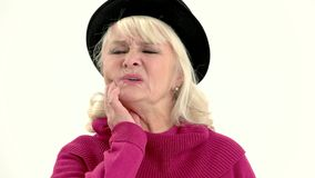 Old woman having toothache isolated. Upset senior lady stock video