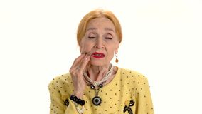 Old woman having toothache. stock footage