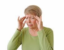 Old woman with a headache. Isolated on the white background Stock Photos